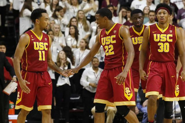 Nov 18, 2016; College Station, TX, USA; USC Trojans guard Jordan McLaughlin (11) and guard De'Anthony Melton (22) low five against the Texas A&M Aggies during the second half at Reed Arena. USC won 65-63. Mandatory Credit: Ray Carlin-USA TODAY Sports