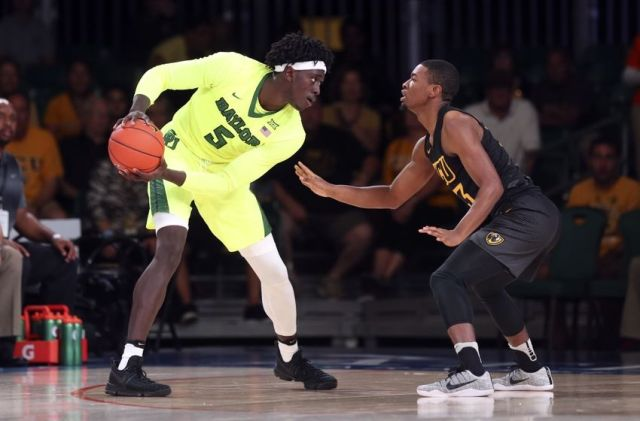 Nov 23, 2016; Paradise Island, BAHAMAS; Baylor Bears forward Johnathan Motley (5) looks to score as Virginia Commonwealth Rams guard Malik Crowfield (13) defends in the first half during the 2016 Battle 4 Atlantis in the Imperial Arena at the Atlantis Resort. Mandatory Credit: Kevin Jairaj-USA TODAY Sports