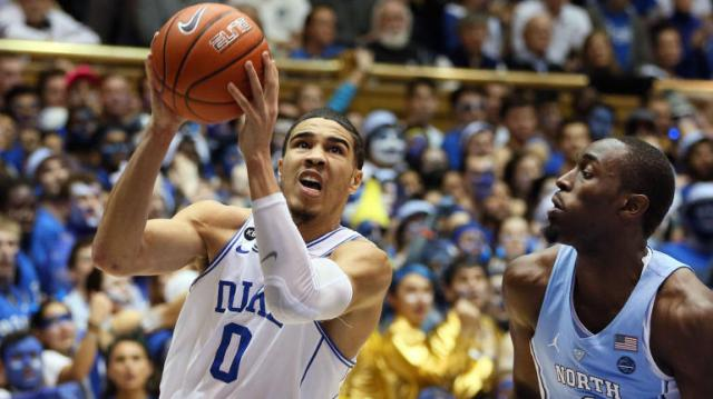 Feb 9, 2017; Durham, NC, USA; Duke Blue Devils forward Jayson Tatum (0) drives against North Carolina Tar Heels forward Theo Pinson (1) in the second half of their game at Cameron Indoor Stadium. Mandatory Credit: Mark Dolejs-USA TODAY Sports